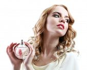image of perfume  - Beautiful young woman with perfume bottle isolate on white - JPG