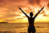 Постер, плакат: Freedom woman silhouette living healthy lifestyle a happy carefree and free life Portrait from the