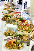 stock photo of banquet  - Dishes on the banquet table on a wedding