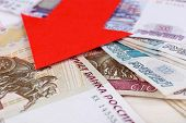 stock photo of depreciation  - Red arrow on Russian money as depreciation of currency - JPG