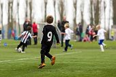 image of football pitch  - Young kids during a boys soccer match on green soccer pitch - JPG