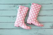picture of rainy season  - Pink polka dot shoes on mint shabby chic wooden background - JPG
