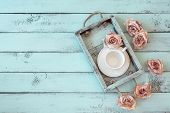 image of mints  - Vintage wooden tray with porcelain teacup and rose buds on shabby chic mint background - JPG