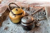 picture of bonfire  - preparing tea in Bedouin camp with teapot over little bonfire - JPG