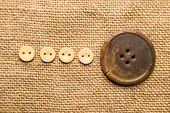 foto of hasp  - A lot of old buttons scattered on the old cloth - JPG