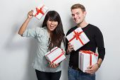 stock photo of multicultural  - A portrait of a multicultural couple celebrating an event - JPG