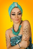 foto of turban  - Beautiful woman in oriental style in turban - JPG
