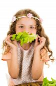 foto of healthy eating girl  - Beautiful healthy little curly girl enjoying eating lettuce isolated on white - JPG