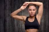 picture of arms race  - Close up photo of young mixed race sporty woman wearing black tracksuit for training - JPG
