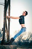 picture of rebel  - young rebel woman in blue jeans - JPG