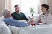 stock photo of father child  - Children caring about terminally ill cancer father - JPG