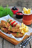 picture of fried chicken  - fried chicken wings with red sauce and French fries  potatoes - JPG
