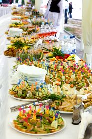 stock photo of banquet  - Dishes on the banquet table on a wedding  - JPG