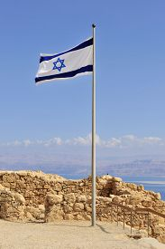 picture of masada  - The Jewish flag in the breeze atop Masada - JPG
