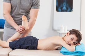 picture of physiotherapist  - Little boy during rehabilitation in physiotherapist - JPG