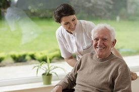 stock photo of nursing  - Smiling senior man staying in nursing home - JPG