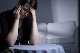 stock photo of cry  - Crying widow having trauma after her husband - JPG