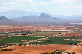 picture of pima  - Agriculture in the desert southwest from above with Red Mountain and Four Peaks in the distance - JPG
