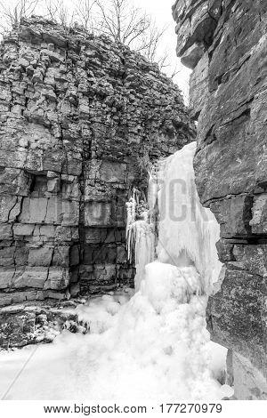Frozen waterfall spilling