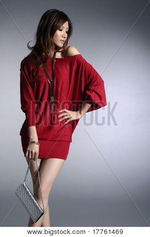 Постер, плакат: Мода фото красивая женщина с мешком, холст на подрамнике