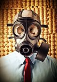 stock photo of gas mask  - portrait of businessman skull wearing classic gas mask - JPG
