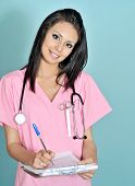 picture of medical assistant  - Beautiful young nurse assistant holding clipboard - JPG