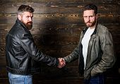 Male Friendship Concept. Brutal Bearded Men Wear Leather Jackets Shaking Hands. Real Men And Brother poster