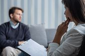 Thoughtful Psychotherapist During Session With Sad Patient With Anxiety Problem poster