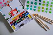 Watercolor Paints And Brushes Workplace Artist With Artistic Tools For Mock Up. poster