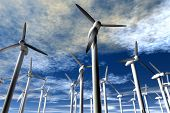 pic of wind-power  - An illustration of wind power generators against a partly cloudy sky - JPG