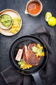 Traditional exotically blackened Cajun style tuna fish fillet with mango avocado salad, chimichurri  poster