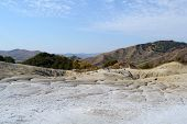 Landscape From The Mud Volcanoes With Hills In The Distance And Dry Mud Ground. poster