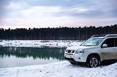 Suv Car At Riverside In Winter Time. Road Trip. Lifestyle poster