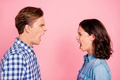 Profile Side View Portrait Of Attractive Mad Fury Furious Anxious Gloomy Couple Looking At Each Othe poster