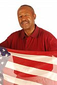 picture of veterans  - African American war veteran holding an American flag - JPG