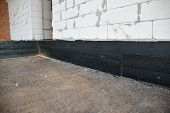 Foundation Bitumen Waterproofing. Building House Construction With Waterproofing Spray-on Tar. Const poster