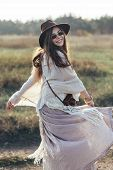 Beautiful Hippie Woman Twirls And Dancing Outdoors. Freedom Woman Spinning Around poster
