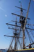 picture of yardarm  - Sailor climbs the rigging on the mast of a tall ship - JPG