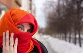 image of yashmac  - young beautiful woman in red purdah against street - JPG