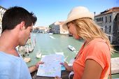 picture of academia  - Couplelooking at map on the Academia Bridge in Venice - JPG