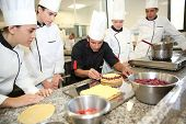 stock photo of french pastry  - Students with teacher in pastry training course - JPG