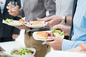 stock photo of buffet catering  - Closeup Of Business People - JPG