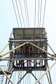 foto of derrick  - drilling derrick in a iron mine in the blue sky - JPG