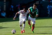 PASADENA, CA - JULY 7: Marcos Sanchez #8 of Panama and Efrain Velarde  #15 of Mexico during the 2013