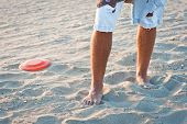 foto of frisbee  - young boy playing frisbee on the beach - JPG