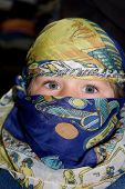 stock photo of yashmak  - Curious European child dressed in headscarf in the Arabian manner - JPG
