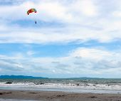 stock photo of parasailing  - Parasailing sport on the eastern sea of Thailand - JPG