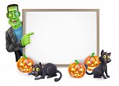 stock photo of frankenstein  - Illustration of a cartoon Halloween sign with Frankenstein classic monster pointing at blank sign ready for your text - JPG