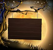 stock photo of spooky  - A scary Halloween wood sign hanging from a spooky tree ready for your message - JPG