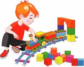 stock photo of little boy  - Little boy playing with his wooden train set - JPG